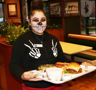 Zombie service with a smile for Halloween, Jailene Rivera a happy Kelly's employee enjoying Kid's Night.
