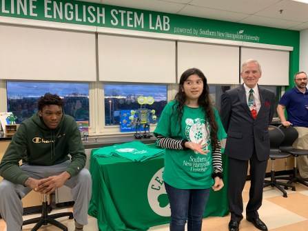 Student Heidi Orellana Ramos explains what her lab table completed during the one-hour Celtics visit.