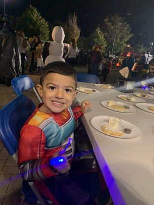 Revere resident Ezequiel Castaneda, 4, was decorating a cookie with cream cheese and chocolate chips at Fright Night on Sunday at Rumney Marsh Academy.