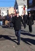 School Committeeman Rob McCarthy is shown leading his peers during the parade.