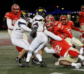 The Tide defense was once again awesome, as linebacker seniors Declan Smith (88) and Gilbert Kabamba (52) bring down a Mustang running back at the line of scrimmage.