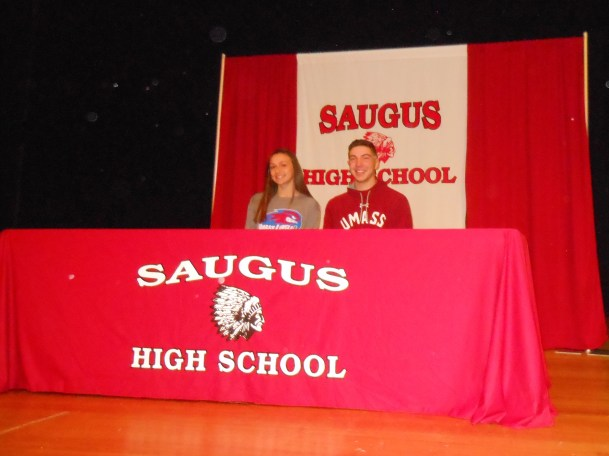 Saugus High School star athletes Allison LeBlanc (left) and Todd Tringale (right) appear Wednesday for a special ceremony to celebrate their letters of commitment to Division 1 colleges. LeBlanc, a standout soccer player, plans to go to the University of Masssachusetts-Lowell to continue her favorite sport. Tringale, a star pitcher on the Sachems baseball team, intends to pitch for the University of Massachusetts-Amherst. (Saugus Advocate Photo by Mark E. Vogler)