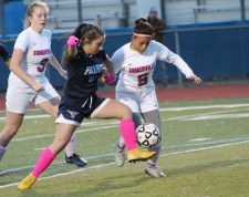 Peabody's Emily McDonough battles a Somerville player for the ball.