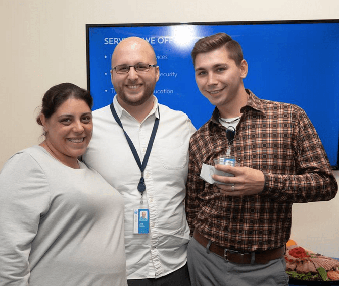 Shown, from right to left, are Jacqueline Davis, owner of Virtually Here, Joseph Silva, owner of Spectra Networks and Spectra's Office Manager Jonathan Cincotta.