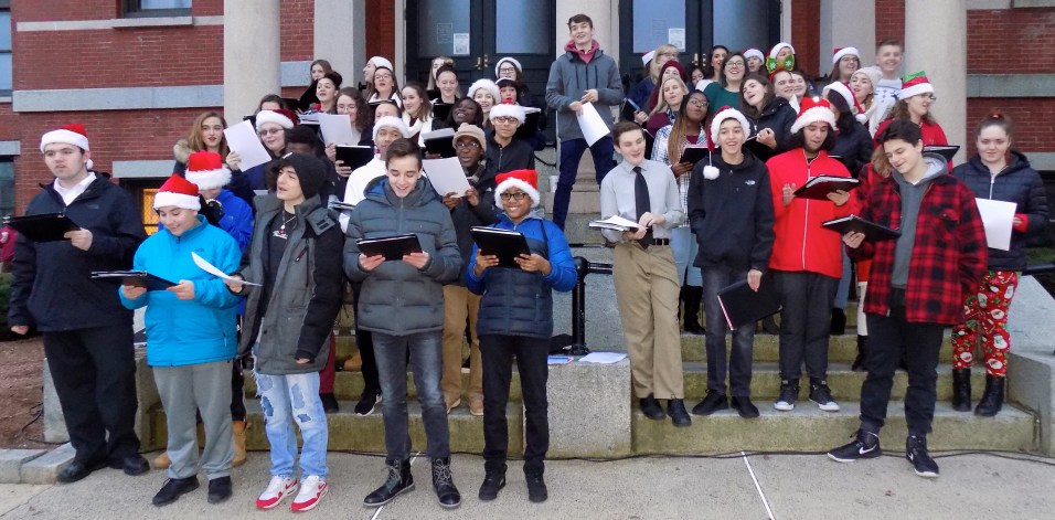 The choir from Peabody Veterans Memorial High School sang Christmas carols on the steps of City Hall.