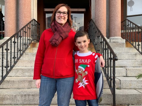 Joyce and James Keenan, 10, are excitedly waiting for Santa to arrive in front of City Hall on Saturday afternoon.