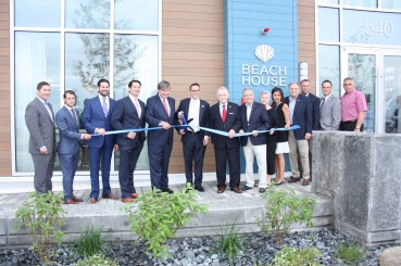City and state officials turn out for the ribbon-cutting of the Beach House condominiums on Revere Beach Boulevard – just one of many new condo and apartment complexes that have begun to fill the beach area.