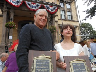 """CITIZEN HEROES: Peter Manoogian and Janette Fasano, left to right, receive the Saugus 2018 """"Persons of the Year Award"""" at this year's Founders Day, which was held in September in front of Saugus Town Hall. (Saugus Advocate Photo by Mark E. Vogler)"""