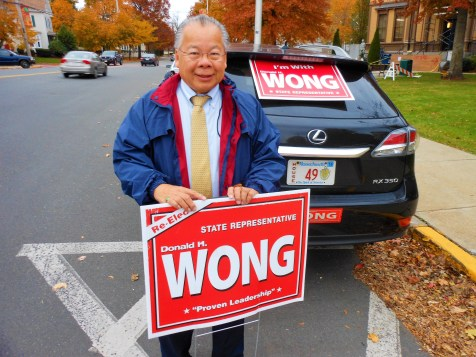 TAKING NOTHING FOR GRANTED: State Rep. Donald Wong campaigned the day before the November election in front of Saugus Town Hall. He beat two opponents decisively as he won a fifth two-year term representing voters of the 9th Essex District. For the first time in his political career, he won every precinct in the three communities he represents.