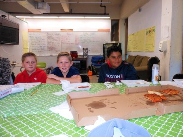 """PLANNING OVER PIZZA: Left to right, sixth graders Stephen Gaffey, George Salsman and Gianni Baez Dellelo enjoy some pizza while listening to the plans of the other members of the student group """"Youth Empowering Saugus,"""" also known as """"The YES Club."""""""