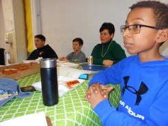 WAITING FOR FEEDBACK: Apollo Fernandes, a sixth grader, listens to reaction to his ideas from School Superintendent Dr. David DeRuosi, Jr. Also interested in the conversation, in the back, left to right, are sixth graders Daniel Zeitz and Tyler Riley and Belmonte Middle School Principal Myra Monto.