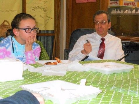 GETTING THEIR OPINION: In an a rare situation that could become very common at the Belmonte Middle School, Saugus Public Schools Superintendent Dr. David DeRuosi, Jr., right, asks a select group of sixth and seventh graders what they like about the school and what they think can be done to make their education better. Seventh grader Allie Souza, left, listens to the suggestions.