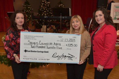 Rosemary Ferraro of East Boston Saving Bank (center) presents a check to Council on Aging Director Joanne Olsen (left) and Rotary President Tara Leary