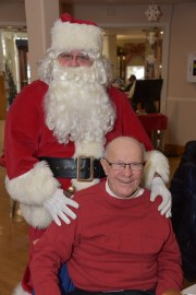 Council on Aging Chairman Richard J. Barry with Santa Claus