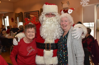 Dottie Bockus and Shirley Bogdan with Santa Claus