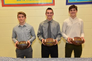 LHS 2018 Varsity Football Game Balls: David Capachietti with the LHS vs Salem ball, Matthew Fiore with the LHS vs Manchester Essex ball, and Jack Ford with the LHS vs Wakefield ball.