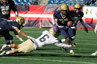 RB John Howell Smith avoids a St. Bernards defender on his to way to a Pope John TD.