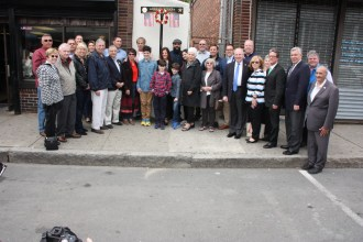 Mayor Brian Arrigo, along with Speaker of the House Rep. Bob DeLeo, with city and state officials and the Haas family honored the late Mayor and Councillor Bob Haas with a Veterans memorial sign outside of the Bagel Bin on Shirley Avenue. The city would also honor the late mayor with a park and bench dedication.