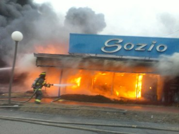 Firefighters are shown battling the February blaze that destroyed the iconic Revere landmark Sozio Appliance on Squire Road.