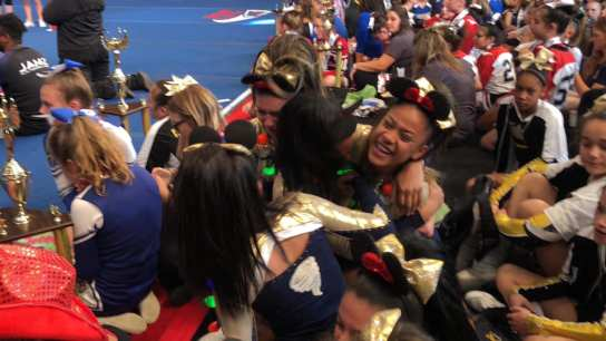 The Malden Cyclones enjoy the thrill of victory at the Pop Warner National Cheer & Dance Championships at Disney World.