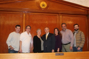 Family friend John Maniscalco, son Arthur Guinasso Jr., wife Linda Guinasso, 2019 City Council President Arthur Guinasso Sr. and family friends Colleen, Paul and Vincent Argenzio show support for Guinasso on Monday at City Hall.