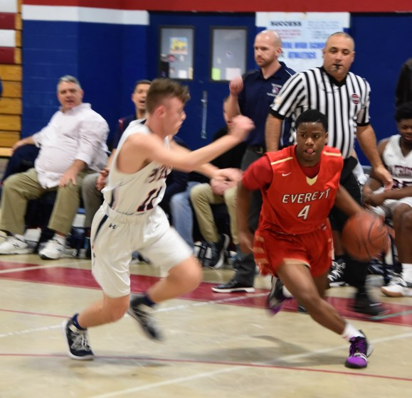Co-Captain Scott Montefusco pressures sophomore Everett guard Omar Quilter.