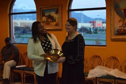 Kimberly Smith, AEHA member and awards moderator (left), presents the AEHA Environmental Health Practitioner of the Year Award to Lorinda Lhotka (right).