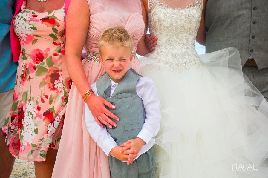 Ring bearer making funny faces during formals. Naal Destination Wedding Photography