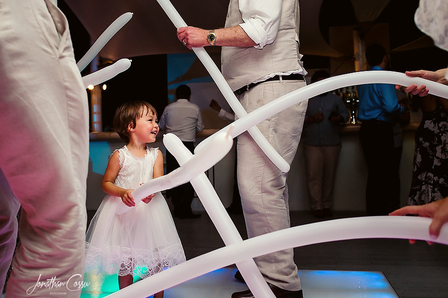 Sweet flower girl having fun on the dance floor. Jonathan Cossu Destination Wedding Photographer