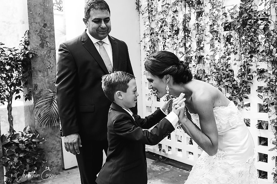 Sweet kids at weddings moment by Jonathan Cossu Photographer at Dreams Sands Cancun.