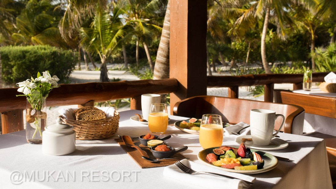 Mukan Resort Breakfast. Fresh tropical fruit, orange juice and coffee. Ael Becker Weddings