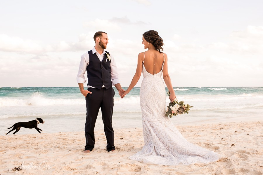 Maggie & Derek's Miracle Wedding in Tulum, Mexico photobombed by a happy running dog. Jonathan Cossu Photographer
