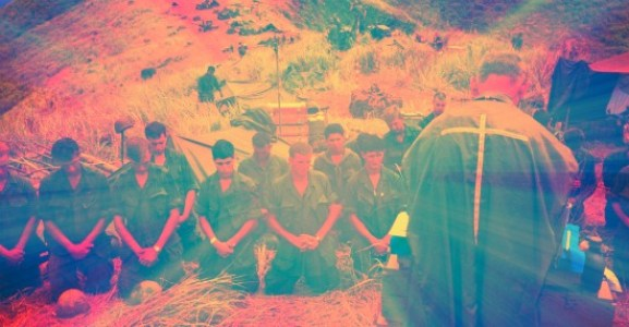 Vietname soldiers praying with Army Chaplain