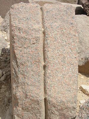 Roman cut on red granite casing block.
