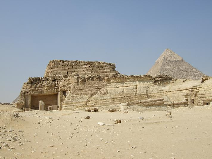 Grand monument of Queen Khentkawes, with Khafre's pyramid in background.