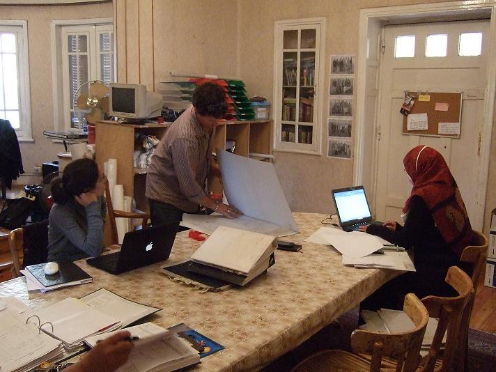 Freya Sadarangani, James Taylor, and Hanan Mahmoud do post-ex work.