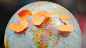 Globe with S-O-S in orange letters stuck to in near the equator