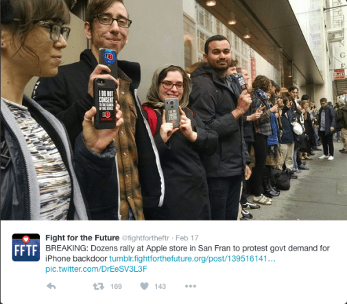 People demonstrating against Governments hacking their iPhones.