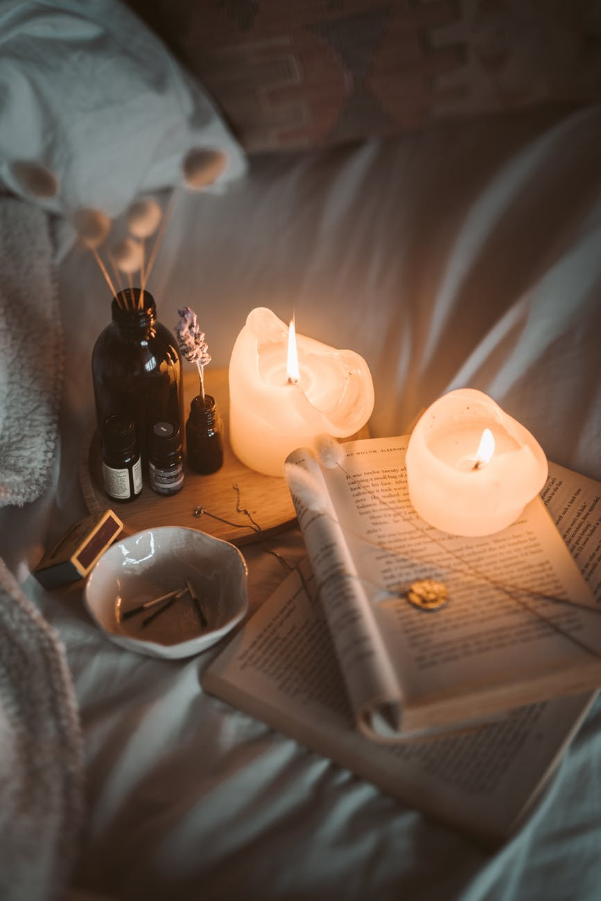 Lighting candles and reading may aid in providing benefits of taking a break.