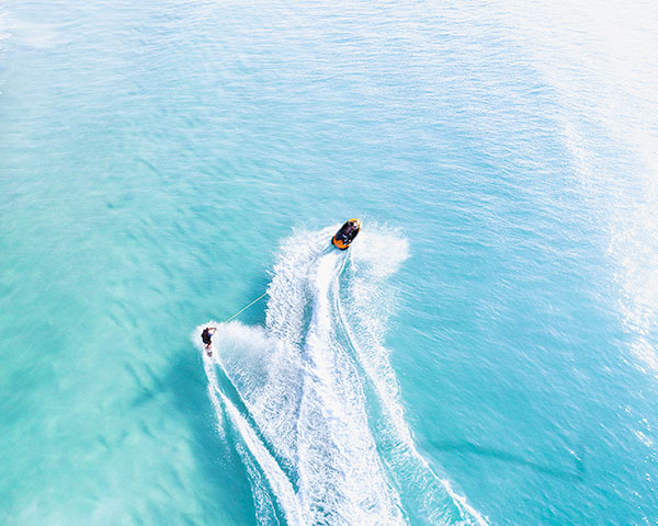 Jet Ski Towing Surfer