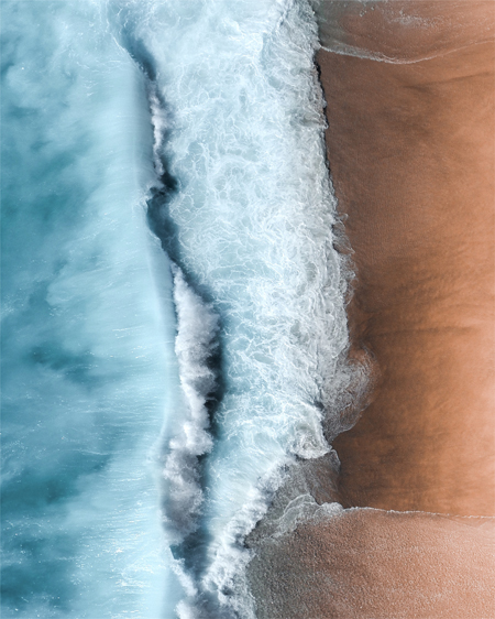 Orange Sands and Light Blue Ocean Aerial