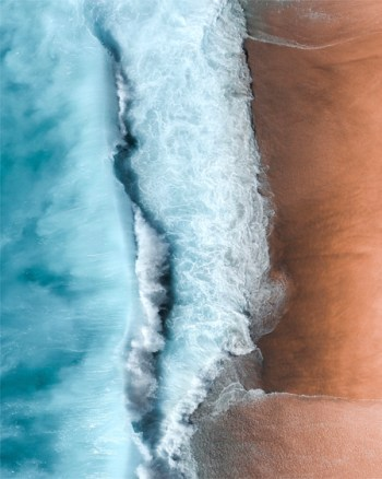 Orange Sands and Light Blue Ocean Aerial