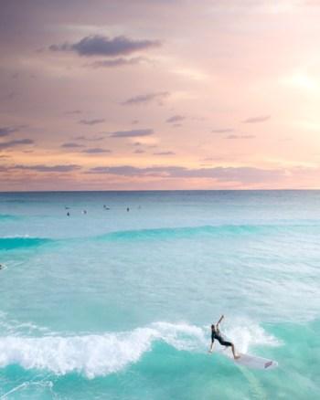 Longboard Surfer Cutting Back On Sunrise