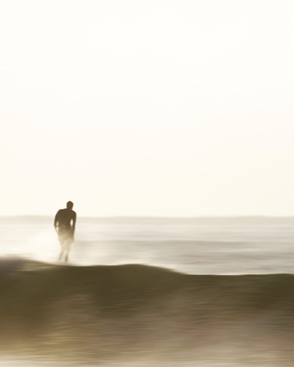Glowing Surfer at Sunrise
