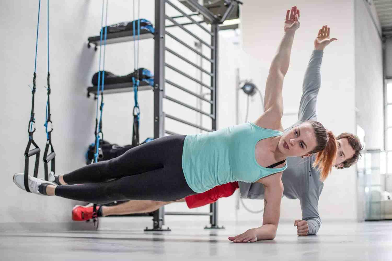 man woman sling training plank exercise gym