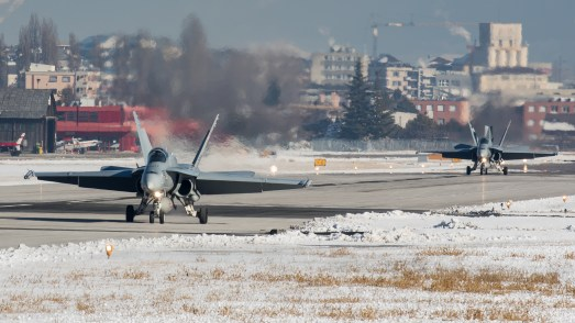 © Adam Duffield - F/A-18C Hornets J-5005 and J-5007 rolling out on landing back at Sion - World Economic Forum Air Policing