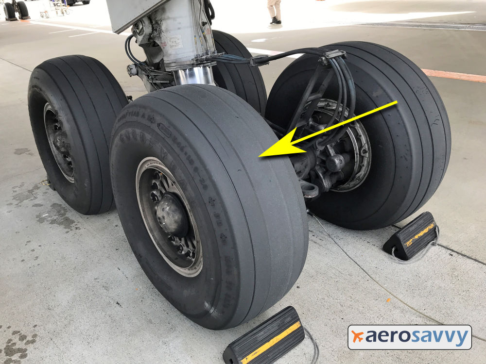 767 Main gear bogie with 4 tires. 3 look new, the 4th has grooves almost worn down even with tread. Grooves are still visible so tire is OK for continued service.