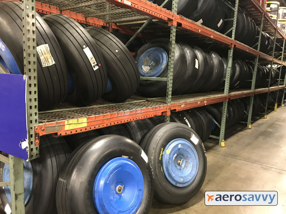 Heavy duty warehouse shelving with a few dozen completed wheels ready for shipment