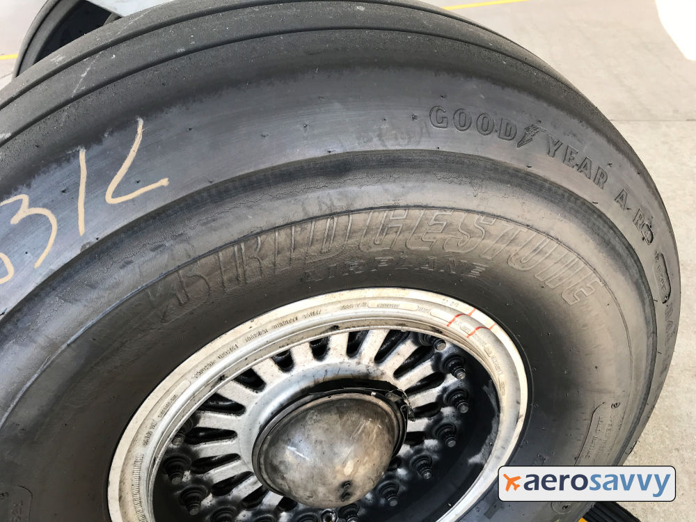767 main wheel with Bridgestone logo on the sidewall. Goodyear logo is on the edge near the tread.