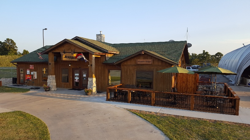 Rustic but new FBO building. Looks like a national park log cabin.